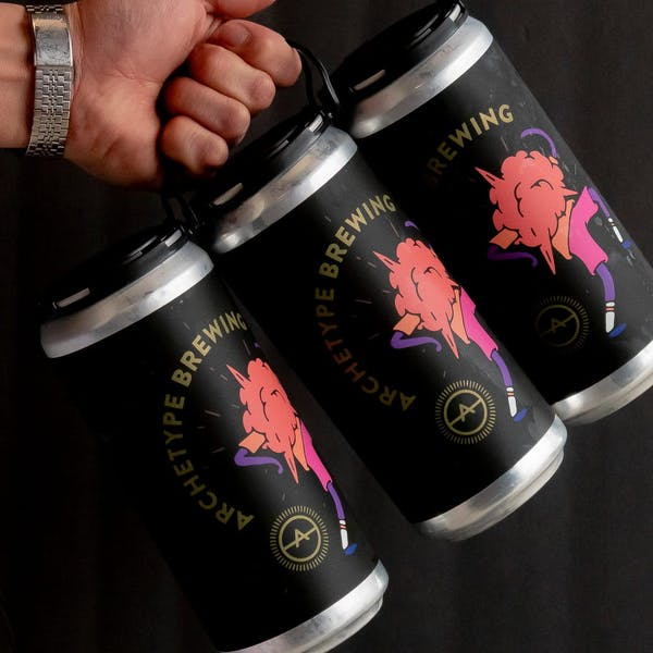 three pack crowler cans being held by a hand