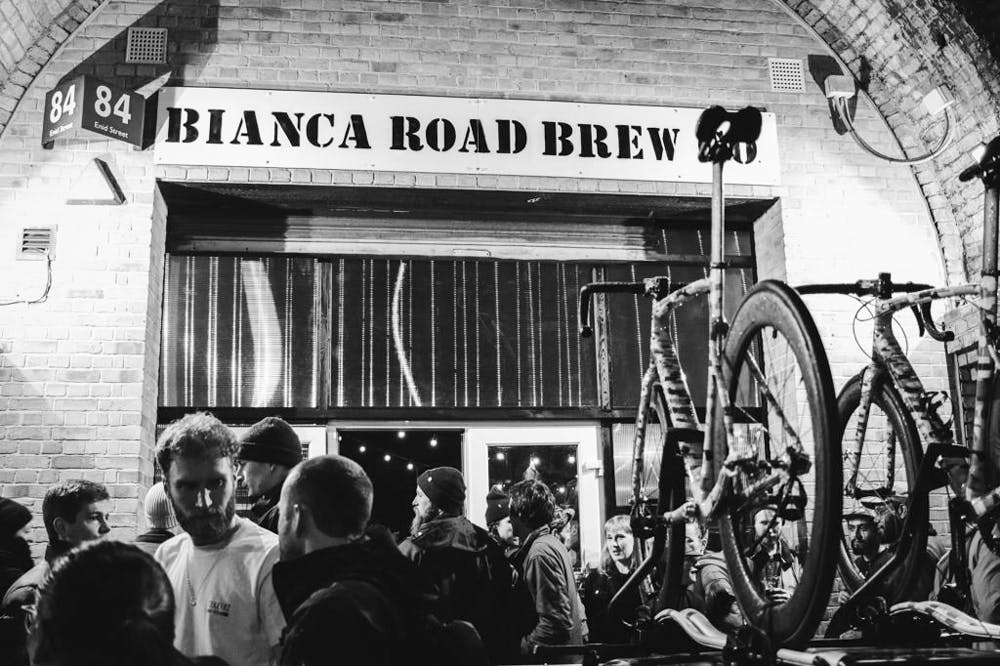 Bikes and people outside of the brewery