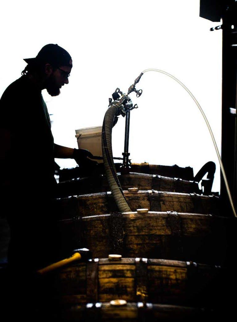 Man filling barrels