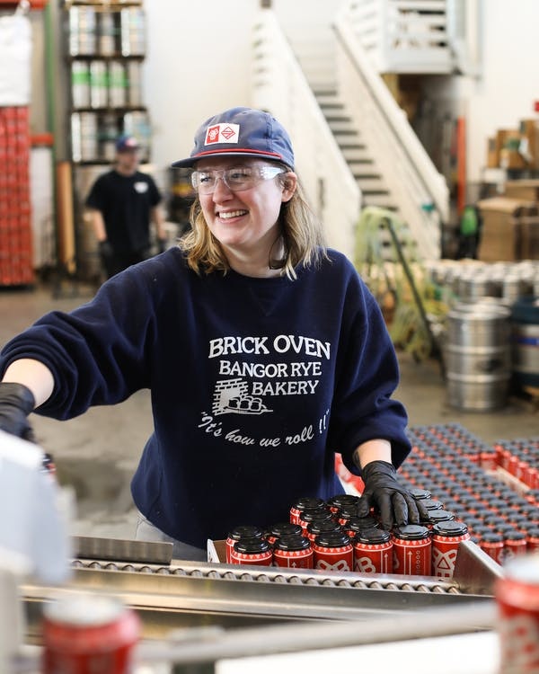 Person working the canning line