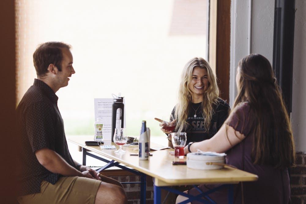 Customers enjoying beer in the bottle shop