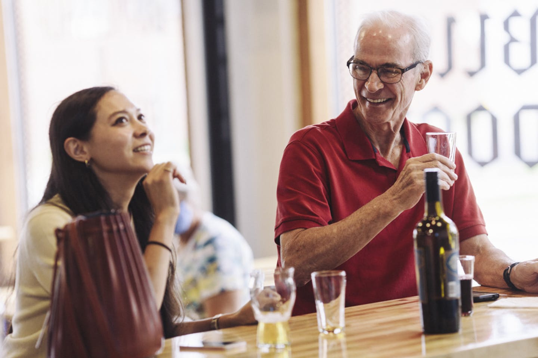 Customers enjoying beer at the bar