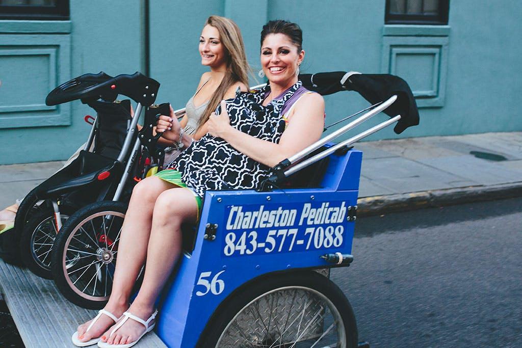 Smiling pedicab passengers