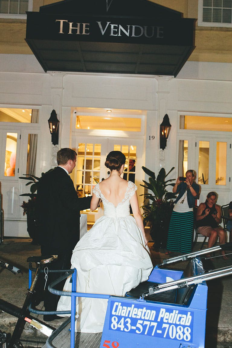 Bride and Groom walk into reception venue