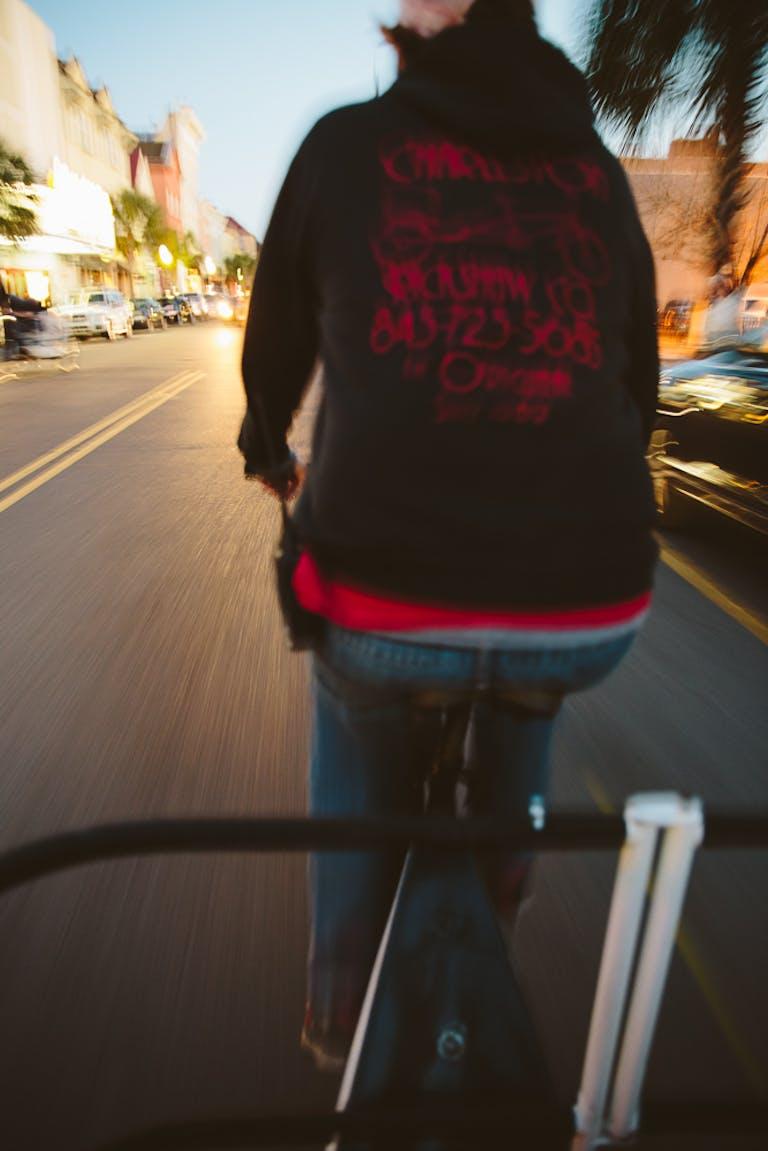 A rickshaw driver zooms through Charleston