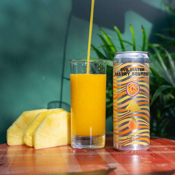 Image or graphic for EVIL WATER PASTRY SELTZER™️ – PASSION FRUIT, PINEAPPLE