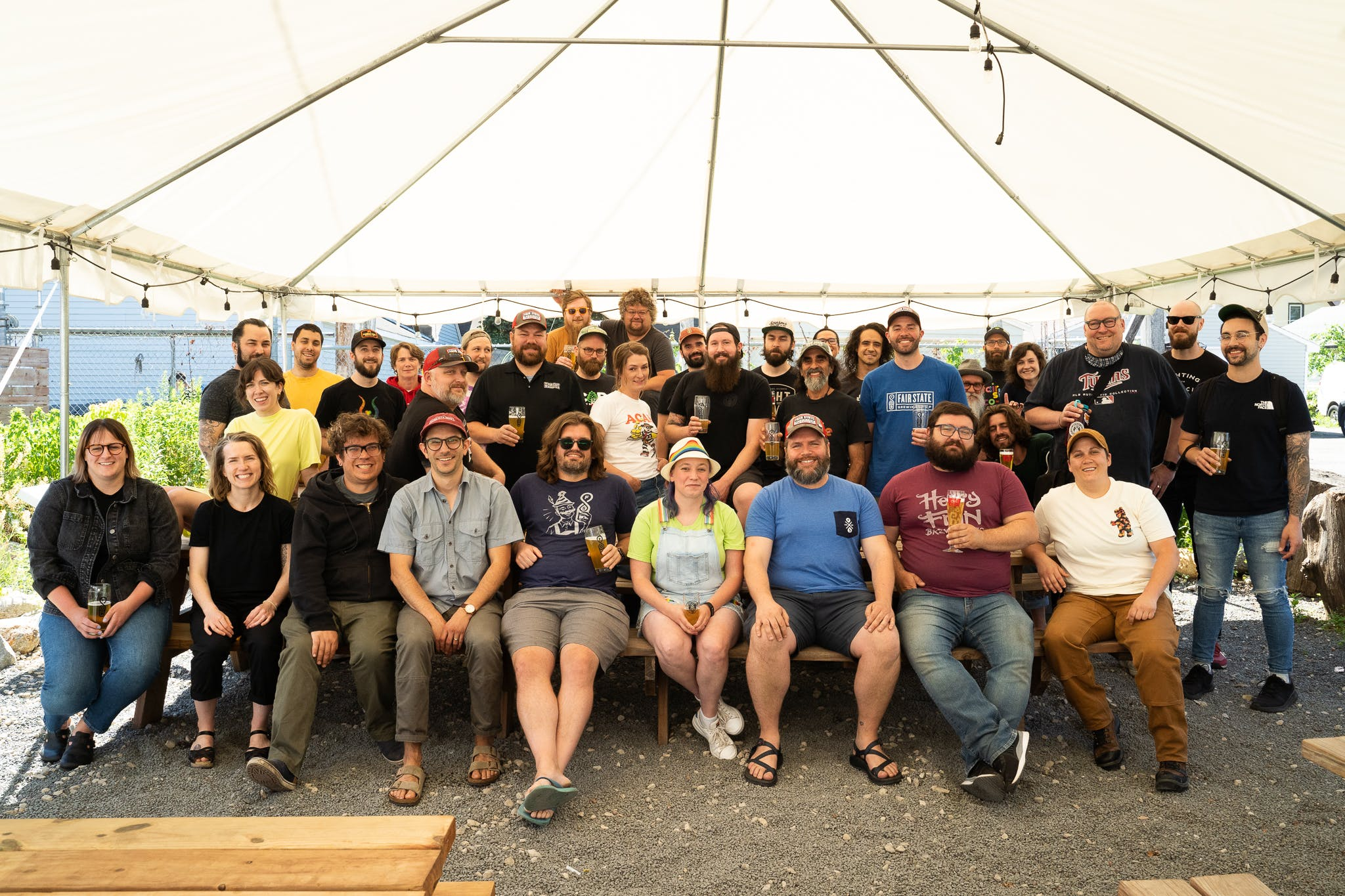 Photo of our full staff outside under a tent in the beer garden.