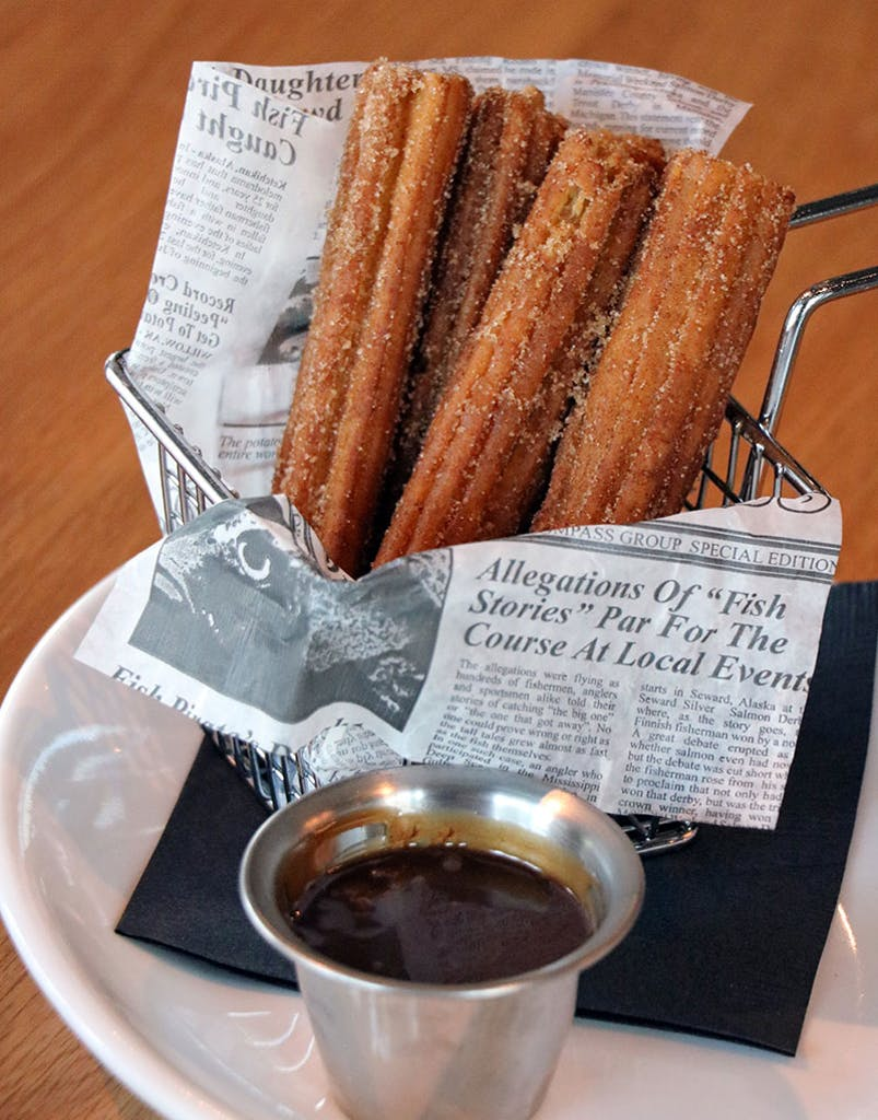 Filled with dark chocolate, churros tossed in cinnamon and sugar, served with a caramel Nutella sauce