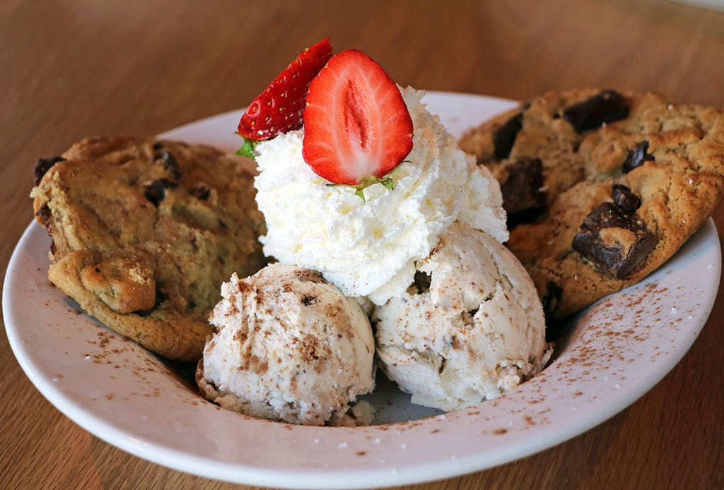 Fresh baked double chocolate chunk cookie served with housemade vanilla ice cream finished with fresh whipped cream
