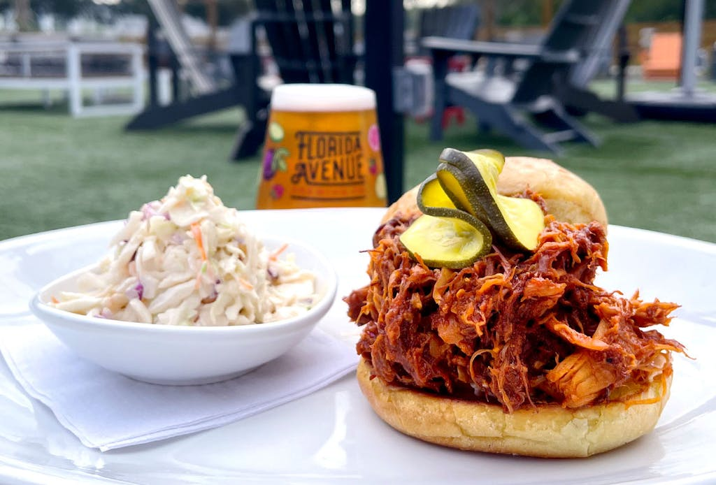 Slow cooked shredded chicken, tossed in house-made Brown sugar BBQ, coleslaw, house-made zucchini pickles on a toasted potato bun