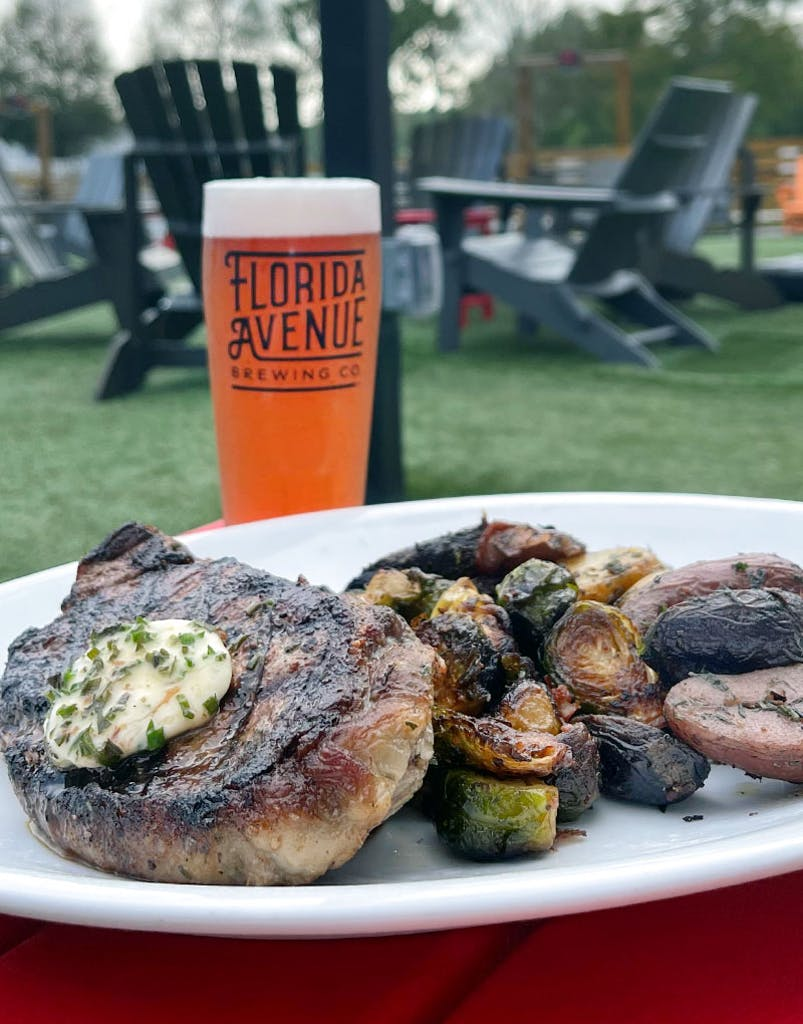 12 oz. hand cut New York strip marinated and grilled, sautéed brussels sprouts with applewood bacon, herb roasted tri-colored fingerling potatoes, A1 herb compound butter