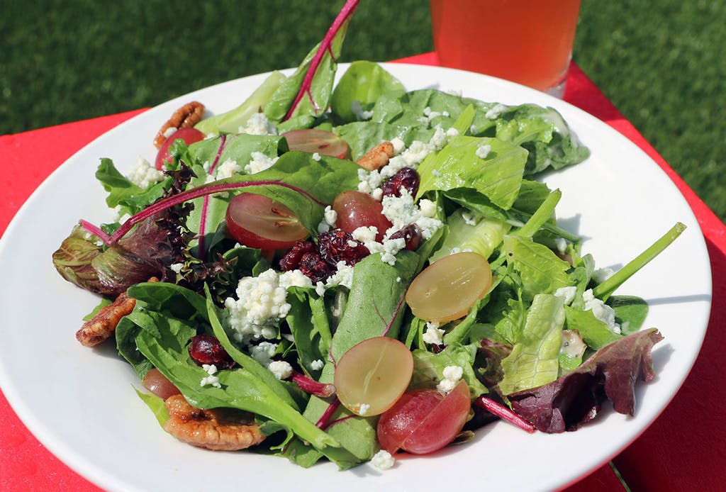 Seasonal mixed greens, red grapes, dried cranberries, candied pecans, blue cheese crumbles, house-made apple cider vinaigrette