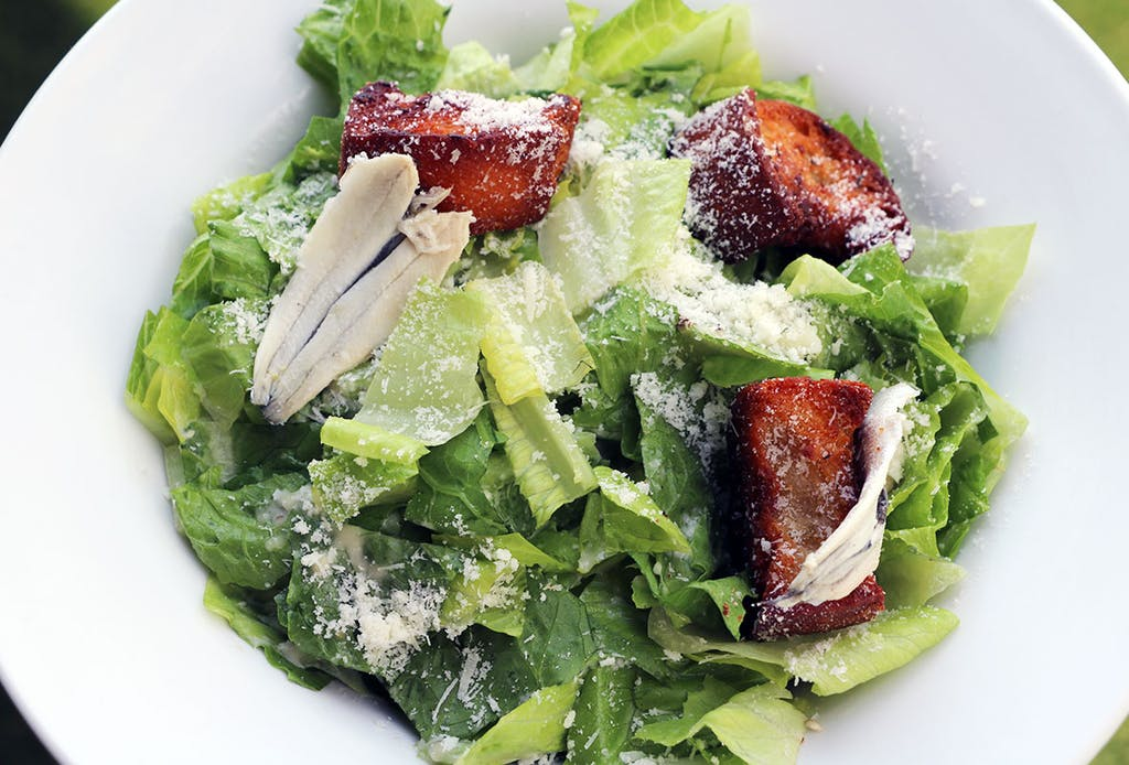 Crisp romaine hearts, house-made garlic butter croutons, white anchovy lemon dressing, parmesan cheese