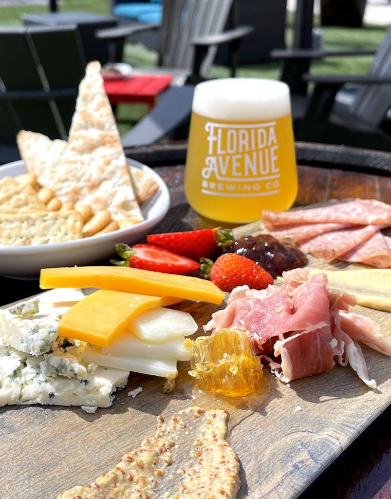 Tillamook cheddar, Stella blue, 3 yr. Manchego cheese, Florida honeycomb, fig spread, cured Italian meats, whole & Dijon mustards, assorted crackers