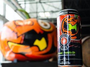 Screamin Pumpkin Ale Can in front of Pumpkin