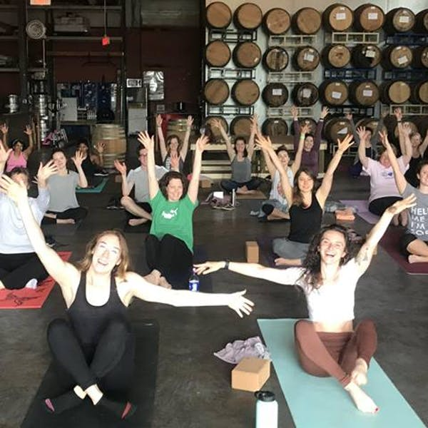yoga class in brewery barrel room