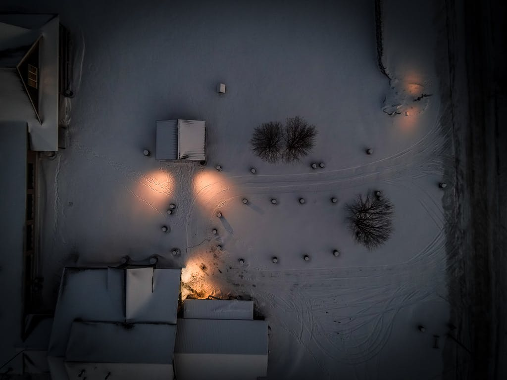 drone curbside at night