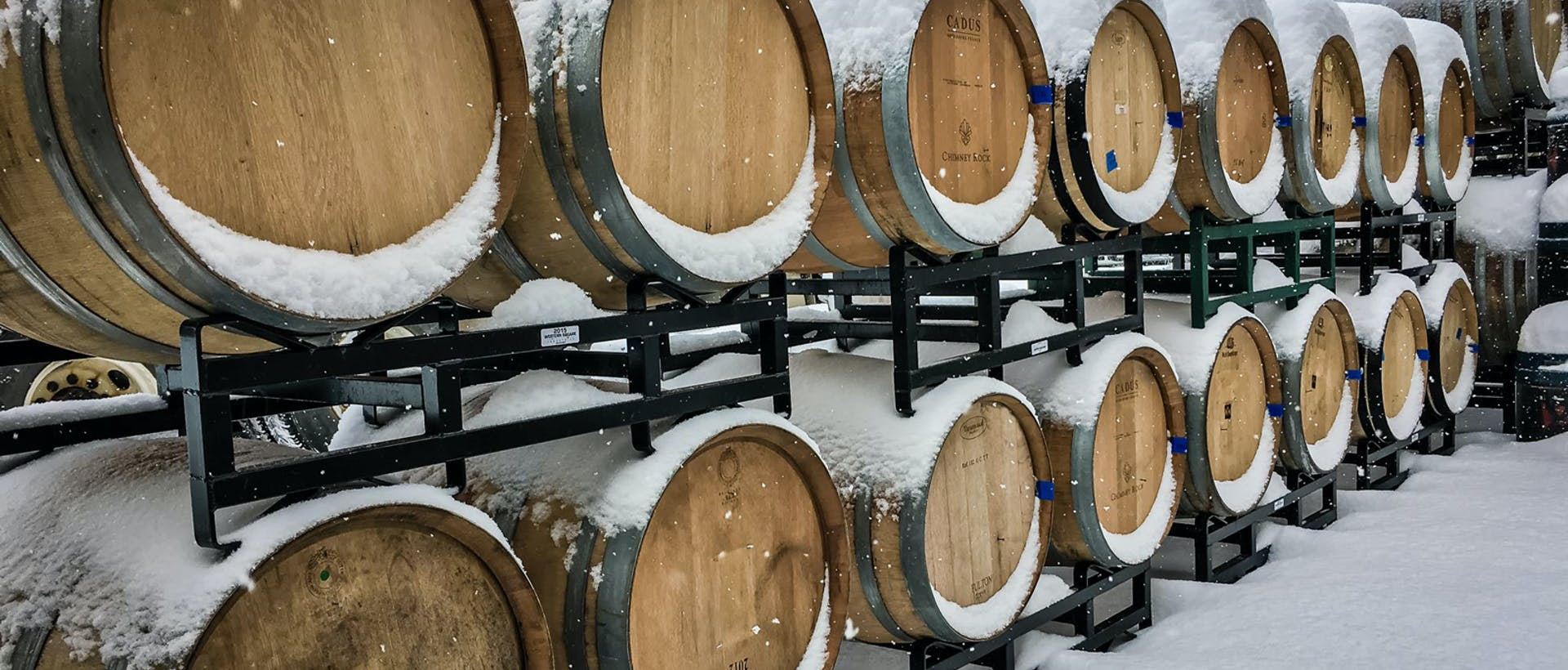 Barrels covered in snow