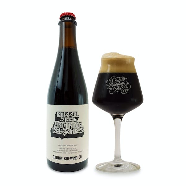 barrel_aged_infinite_darkness_bottle_and_glass_pour