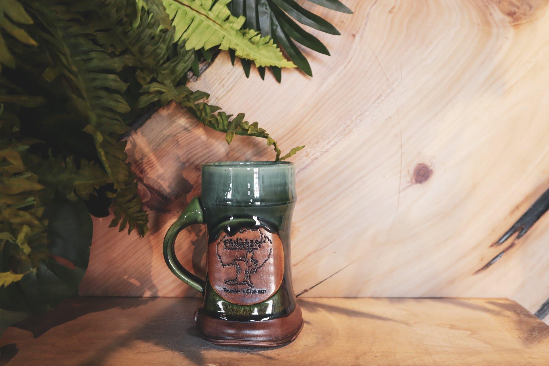 The Pangaea taproom with a mug club mug