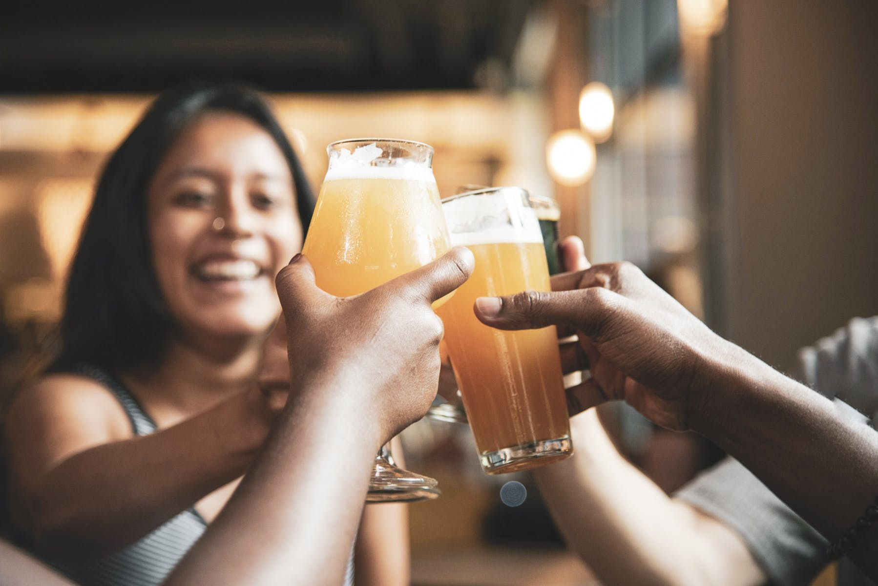 Cheer-sing with Pangaea draft beer in a glass