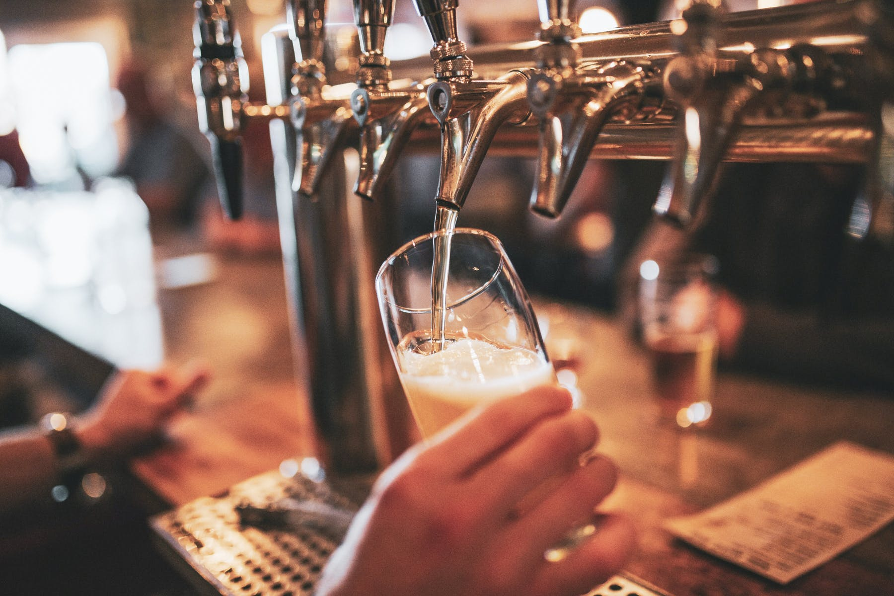 Pouring a Pangaea draft beer in a glass