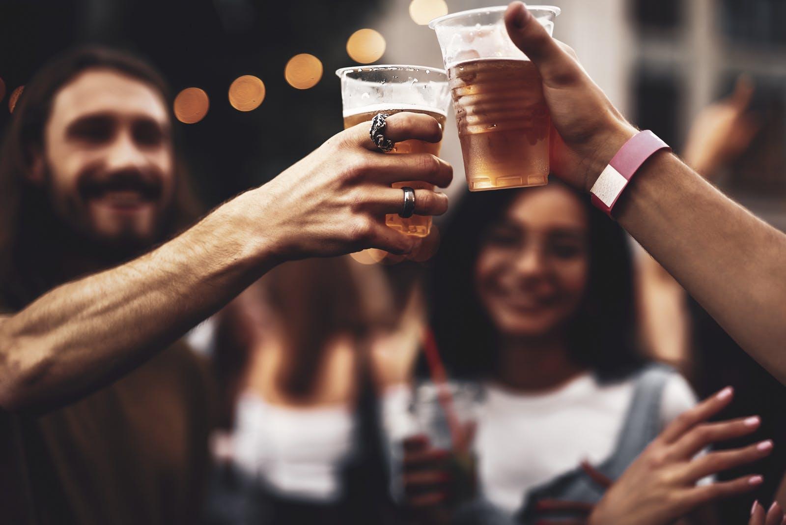 Friends raising cups of beer