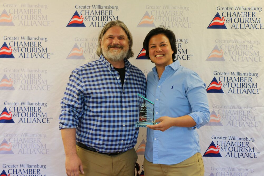 Michael Rhodes, VBC Director of Sales, and Luci Legaspi, VBC Taproom Manager & Business Developer, accept the 2018 Early Stage Small Business of the Year Award for the Virginia Beer Co.